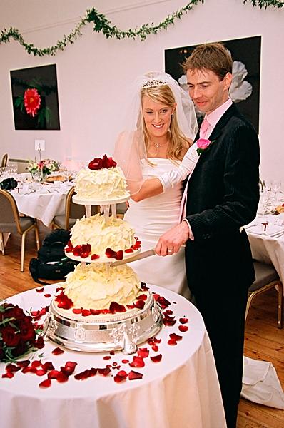 Rachel Finlayson cutting her wedding cake