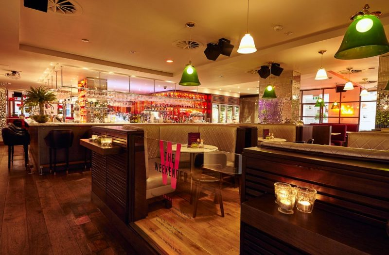 Hotel PR photograph of Tigerlily's luxurious booths and bar seating for customers