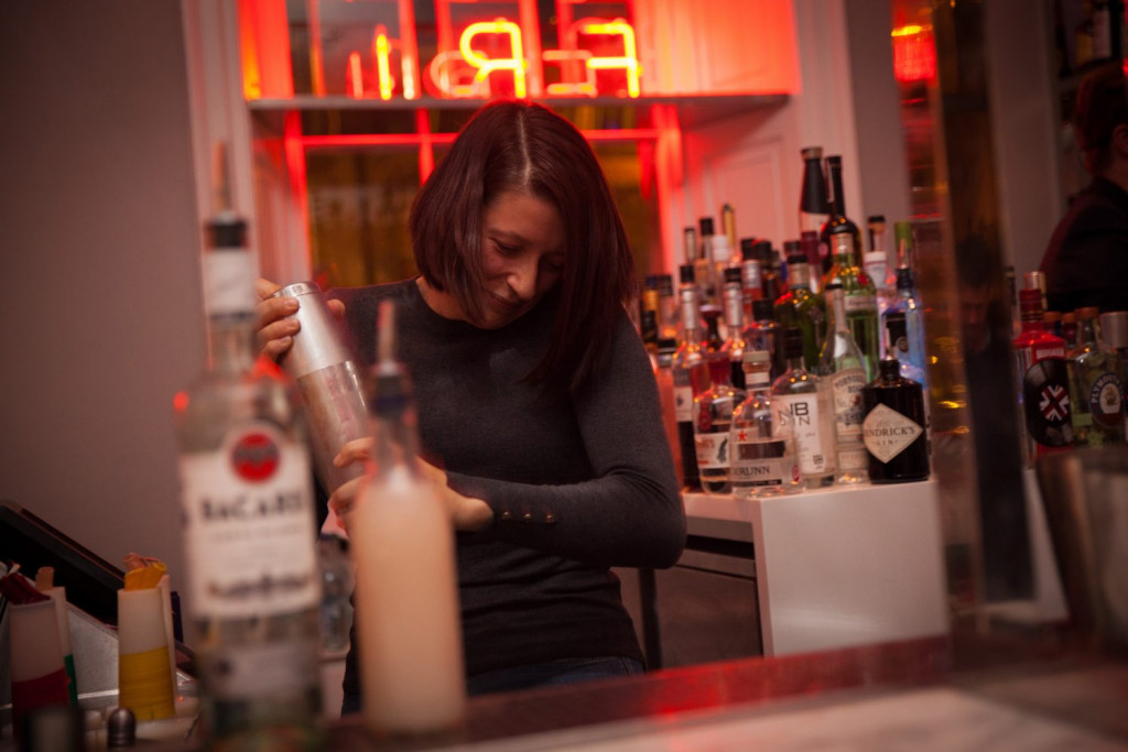 PR photograph of an enthusiastic guest making a cocktail at Tigerlily, Edinburgh