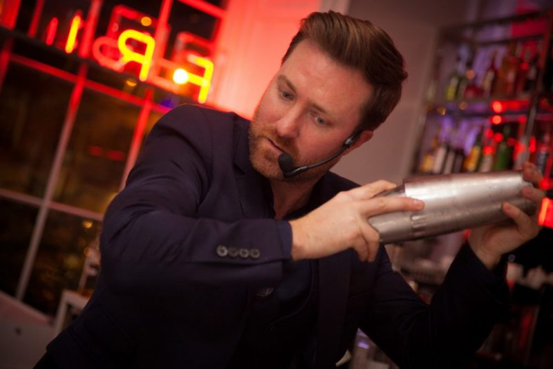 A mixologist giving a cocktail making masterclass at Tigerlily
