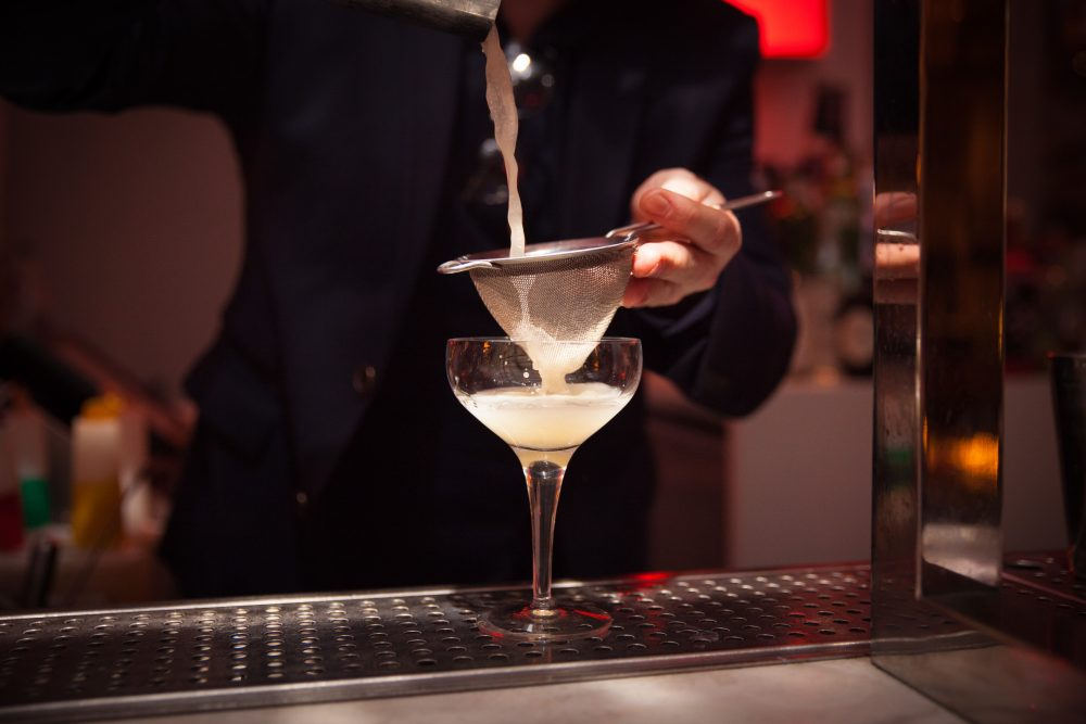A mixologist demonstrates his skills during a cocktail-making masterclass