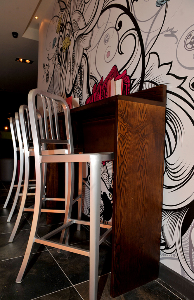 silver stools and feature wall at Hyde Out style bar