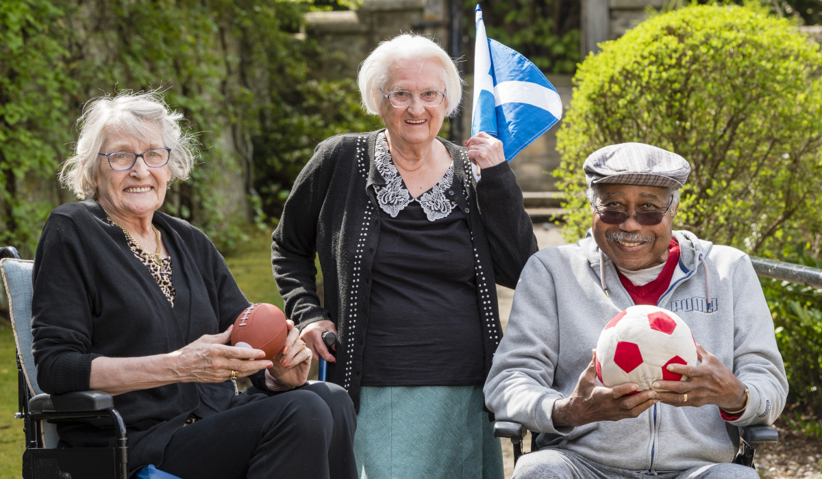 Social care PR photography Mansfield Care, Pine Villa, Loanhead residents participating in their activities afternoon including using the new sports table.